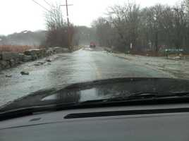 A water-covered road in Acushnet.