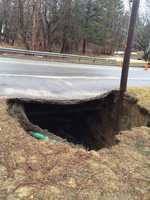 Police said heavy rain opened up this sinkhole on Boston Road near Brian Road in Chelmsford. The road won't be reopened until at least Thursday.