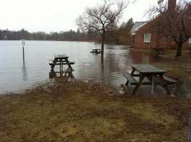 Pond water overflowed at Buttonwood Park in New Bedford.