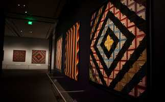 While walking through the gallery, visitors view quilts in eight sections with eight color theories.