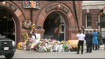 The growing memorial outside Boston Fire Engine 33, Ladder 15 on Boylston Street in Boston.