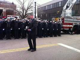 Lt Walsh's helmet being walked to his funeral