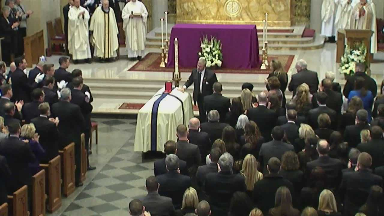 Dad lays Medal of Honor on fallen firefighter's casket