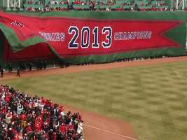 In an hourlong pregame ceremony, Red Sox distributed the World Series rings and unfurled the franchise's eighth championship banner at Fenway Park on Friday.