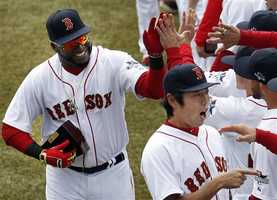 Ortiz and relief pitcher Koji Uehara celebrate with teammates.