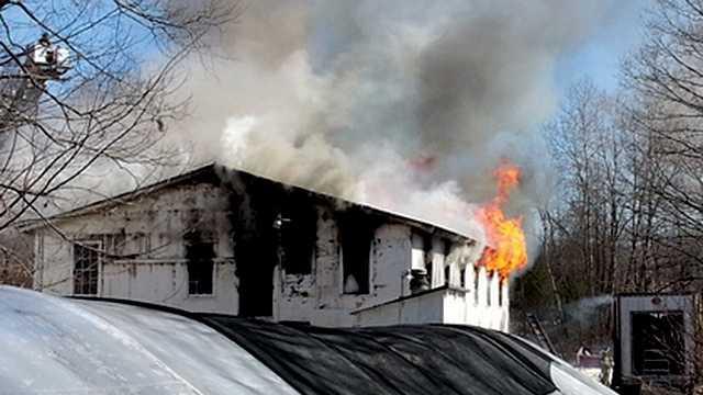 Firefighters battle barn fire in Belmont