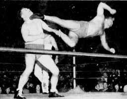 "John E. ""Dropkick"" Murphy was a Massachusetts professional wrestler. Murphy, who died in 1977, is seen here in action."