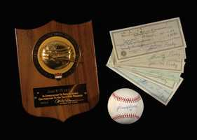 "1953 Johnny Pesky ""100,000 Mile Club"" plaque with related signed checks."