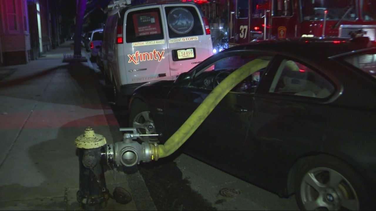img-Boston firefighters smash through car s windows to reach fire hydrant