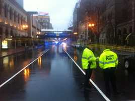 Boston police investigate the discovery of two suspicious backpacks at the finish line at the Boston Marathon Tuesday evening.