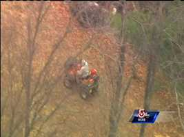 Sky 5 spotted an ATV searching the wooded area near the highway.