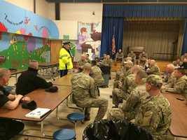 A Mass State Police team is briefed on security plans.