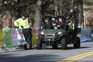 Police officers give a rundown of the scene at Wellesley College to a State Police Special Response team before the start of the 118th Boston Marathon Monday, April 21, 2014 in Wellesley.