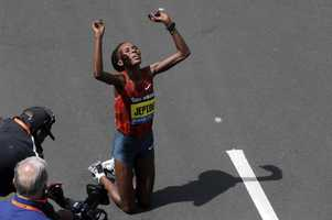 Rita Jeptoo, of Kenya, celebrates her win in the women's division of the 118th Boston Marathon Monday, April 21, 2014 in Boston.