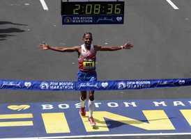 Meb Keflezighi, of San Diego, Calif., breaks the tape to win the 118th Boston Marathon Monday, April 21, 2014 in Boston.