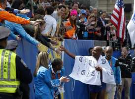 Race fans congratulate Meb Keflezighi, of San Diego, Calif., on his win in the 118th Boston Marathon.