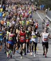 The elite men compete in the 118th Boston Marathon Monday, April 21, 2014 in Hopkinton, Mass.