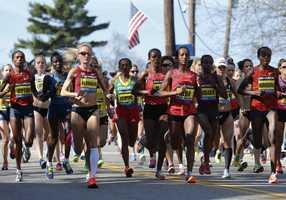 From left, Rita Jeptoo, Shalane Flanagan, Yeshi Esayias, Buzunesh Deba, Mare Dibaba, and Jemima Jelagat Sumgong run shortly after the start in the women's division of the 118th Boston Marathon Monday, April 21, 2014 in Hopkinton, Mass.