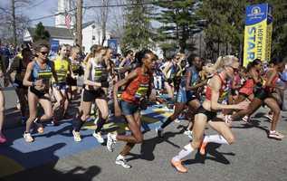 Elite women runners leave the start line of the 118th Boston Marathon Monday, April 21, 2014 in Hopkinton, Mass.