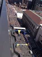 Thounsads of runners begin to cross the finish line of the 118th Boston Marathon Monday, April 21, 2014.