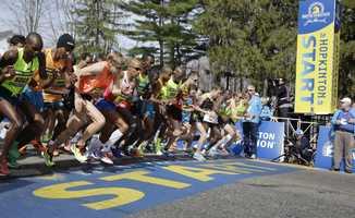 Elite men runners leave the start line in the 118th running of the Boston Marathon Monday, April 21, 2014, in Hopkinton, Mass.