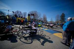 The hand cycles portion of the race begins at the starting line of the Boston Marathon in Hopkinton, Mass.