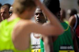 The elite men prepare to run at the starting line of the Boston Marathon in Hopkinton, Mass.