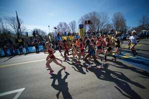 The elite women begin to run at the starting line of the Boston Marathon in Hopkinton, Mass.