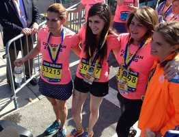 Marathon bombing survivors Syndey and Celeste Corcoran run the last stretch of the Boston Marathon and cross with Celeste's sister.