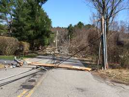 Downed power lines closed Woburn Street in Andover.