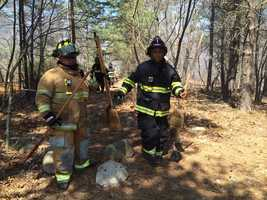 Firefighters battled a brush fire on the Salem-Lynn line.