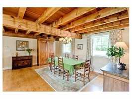 The 6,500 square foot main residence is a converted post and beam barn featuring high ceilings and large rooms.