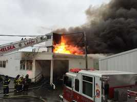 A three-alarm fire broke out inside a kitchen area at Suffolk Downs in Revere late Tuesday afternoon.