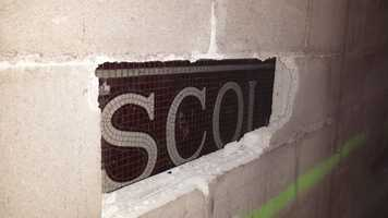 This sign is located at the opposite side of the stairs from the mosaic that was found in early April.