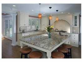 Open kitchen family room with another beverage station great for entertaining