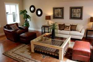 The living room measures 18.5 x 27.75 square feet.