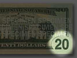Green 20 - A large, green numeral 20 is located in the lower right corner on the back of the bill.