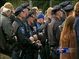 A vigil honoring Brentwood, N.H., police officer Stephen Arkell is held one day after he was shot and killed while responding to a domestic disturbance call.