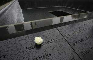A flower has been placed next to the name of a victim of the September 11, 2001 attacks that has been engraved at the National September 11 Memorial & Museum.