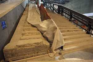 The original stairway from the World Trade Center Plaza to Vesey Street was installed in the cavernous space below the World Trade Center memorial plaza.