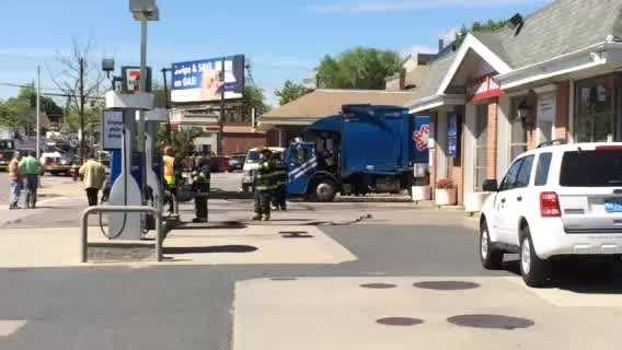Downed wires trap driver in trash truck