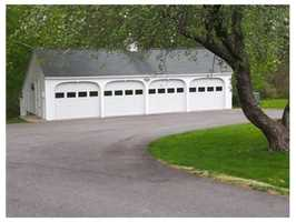 Detached 4 car garage with heat & a/c and another 2 car garage with workshop/storage space allows for ample car storage.