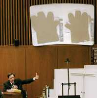 California Department of Justice scientist Gary Sims talks about blood evidence detected on gloves found at the Bundy Drive home of Nicole Brown Simpson and the Rockingham home of defendant O.J. Simpson during testimony Tuesday, May 16, 1995 in Los Angeles.