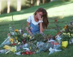 "Kimberly Goldman, sister of murder victim Ronald Goldman, sits and weeps at Ronald's gravesite in Agoura, Calif.,, Oct. 3, 1995. Kimberly came to the gravesite after the jury in the O.J. Simpson murder trial came back with a ""not guilty"" verdict."