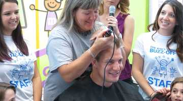 "New England Patriots tight end Rob Gronkowski did his part to tackle pediatric cancer Sunday morning, shaving his head at a ""Cancer Buzz-Off"" for the fourth year in a row."