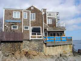 Check out the setting of The Barnacle in Marblehead. This family-owned restaurant is a cozy place to grab chowder and even has its own lobster boats.