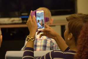 One of her family members snaps a photo of her speaking to the A Plus scholar group