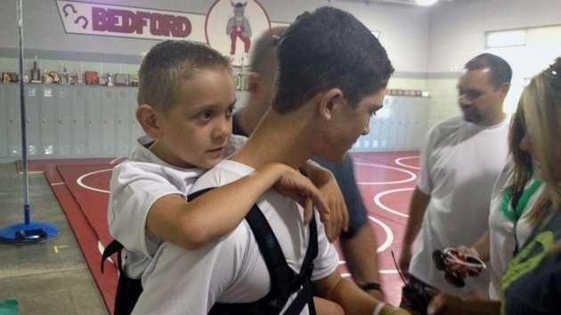 Teen carries brother