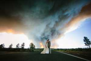 The wedding venue was on the edge of the wind-pushed fire and deputies and fire trucks were driving through the area telling people to evacuate as a precaution.