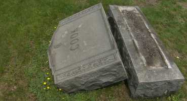 Police are investigating a case of headstones being knocked over at a local cemetery.